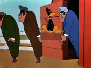Daffy being carried by two thugs