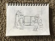 Two people drawing