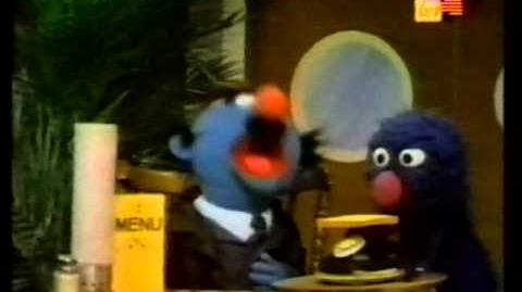 Sesame Street - Grover as food server (in Malay)