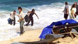 Jack Sayid dragging luggage