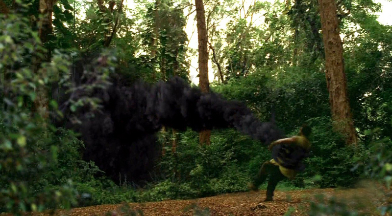 The black smoke monster capturing someone and pulling them into the forest in Lost (2006)