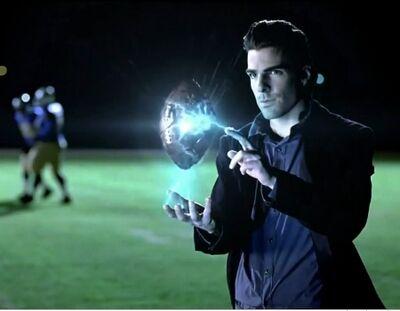 SuperbowlCommercialSylarPopstheFootball