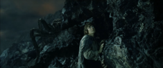 Frodo ambushed by Shelob