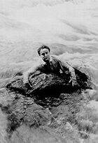 Houdini swims river in scene from The man from beyond (cropped)