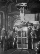 Houdini performing Water Torture Cell