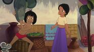 Mowgli is showing Shanti a pan