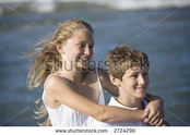 Stock-photo-caucasian-pre-teen-girl-with-arms-around-pre-teen-boy-on-beach-2724290-1-