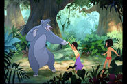 Baloo the Bear is haveing fun with Mowgli and Shanti