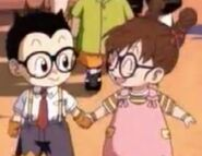 Arale holding Obtochaman holding their hand each other
