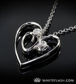 Heart-shaped-pendant-with-2-diamonds