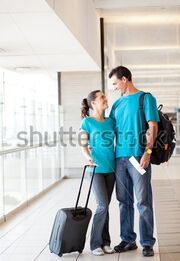 Stock-photo-happy-young-couple-at-airport-97454981