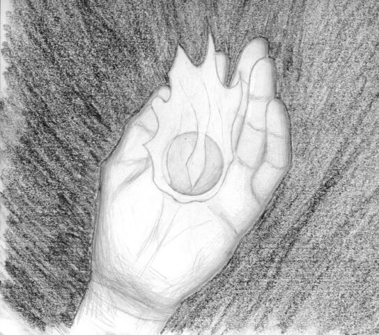 File:Sphere in hand.jpg