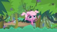 Minka swinging on vines