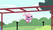 Minka swinging on monkey bars