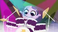 Ocho on drums