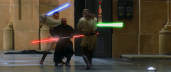 Three men fight with laser swords in a hangar.