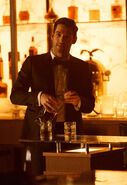 111 promo Lucifer pours drink