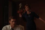 Joan smash a vase over Greg