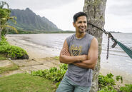 Magnum (Hernandez) standing beside the palm tree