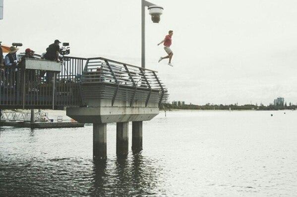 File:Erik jumping off pier.jpg