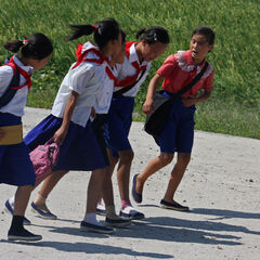 N. Orientalian school kids flee the coming of the dope crazed Haruko and gang.