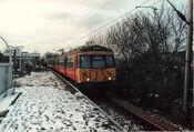 Class 303 016 at Langside