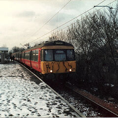 A electric train in the north western New Belfast suburb Newton in 1000AF.