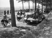 Bren gun carriers pass Belgian refugees on the Brussels-Louvain road, 12 May 1940. F4405
