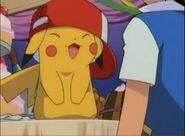 Ash poniendo su gorra a pikachu feliz 1