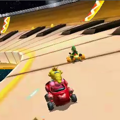 Peach and Yoshi, driving on the giant piano.