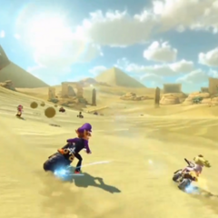 Waluigi and Peach racing at the track.