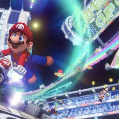 Mario racing in <i>Mario Kart 8</i>s Rainbow Road.