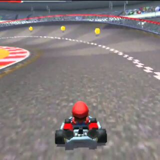 Mario coming across the final turn. The 2nd shortcut is to the left.