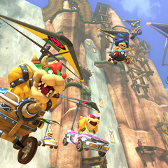 Bowser, Roy, Iggy, Larry, Lemmy and Ludwig, gliding at Shy Guy Falls.