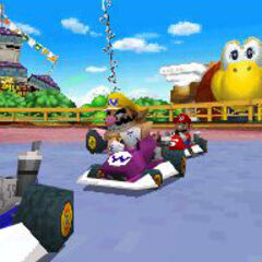 Wario and Toad in the track racing.