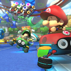 Baby Mario, Baby Luigi, and Baby Peach, racing along the track.
