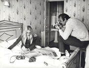Bond taking pictures of Tracy in bed