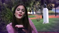 Tini blowing a kiss