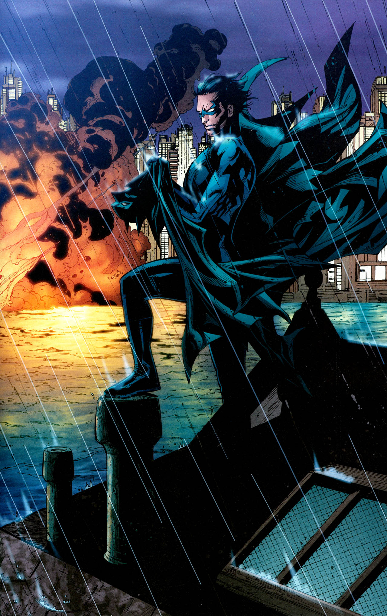 Nightwing Holding The Cape And Cowl