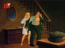 Betty Helps Ross Put on Shirt