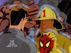 Firefighter Holds Spider-Man Mask