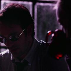 Murdock habla con Page.