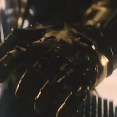 Thanos poniéndose el Guantelete del Infinito.