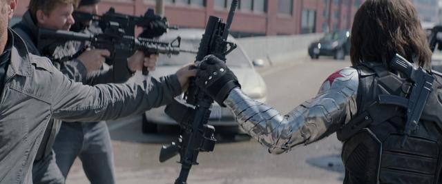 File:Bucky taking a gun.png