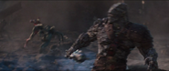 Korg gets hit by the ship's blasts