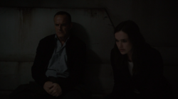 Coulson and Simmons in the room