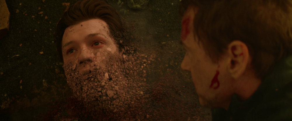 Spiderman being dusted after Thanos do the snap