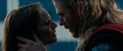 Jane and Thor about to kiss