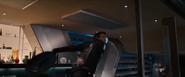 Hawkeye throwing Cap's shield