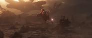 Star-Lord shooting Thanos